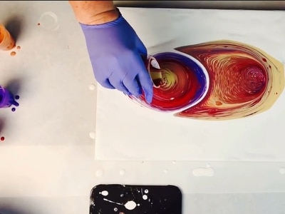 Feeling stressed? This paint-pouring art will chill you out