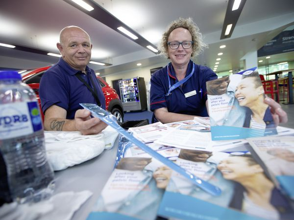 Picture By Peter Frankland. 21-06-21 World Continence Week 2021 is a health campaign to raise awareness of continence related issues. A stall has been set up at Beau Sejour to raise awareness and to answer any questions people might have regarding continence issues..L-R - Stephen Mundy, Urology Nurse Specialist is holding a catheter and Patricia McDermott, Consultant CNS Urology is holding an information leaflet about exercise... (29679916)