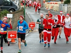 Santa Clauses running to Town