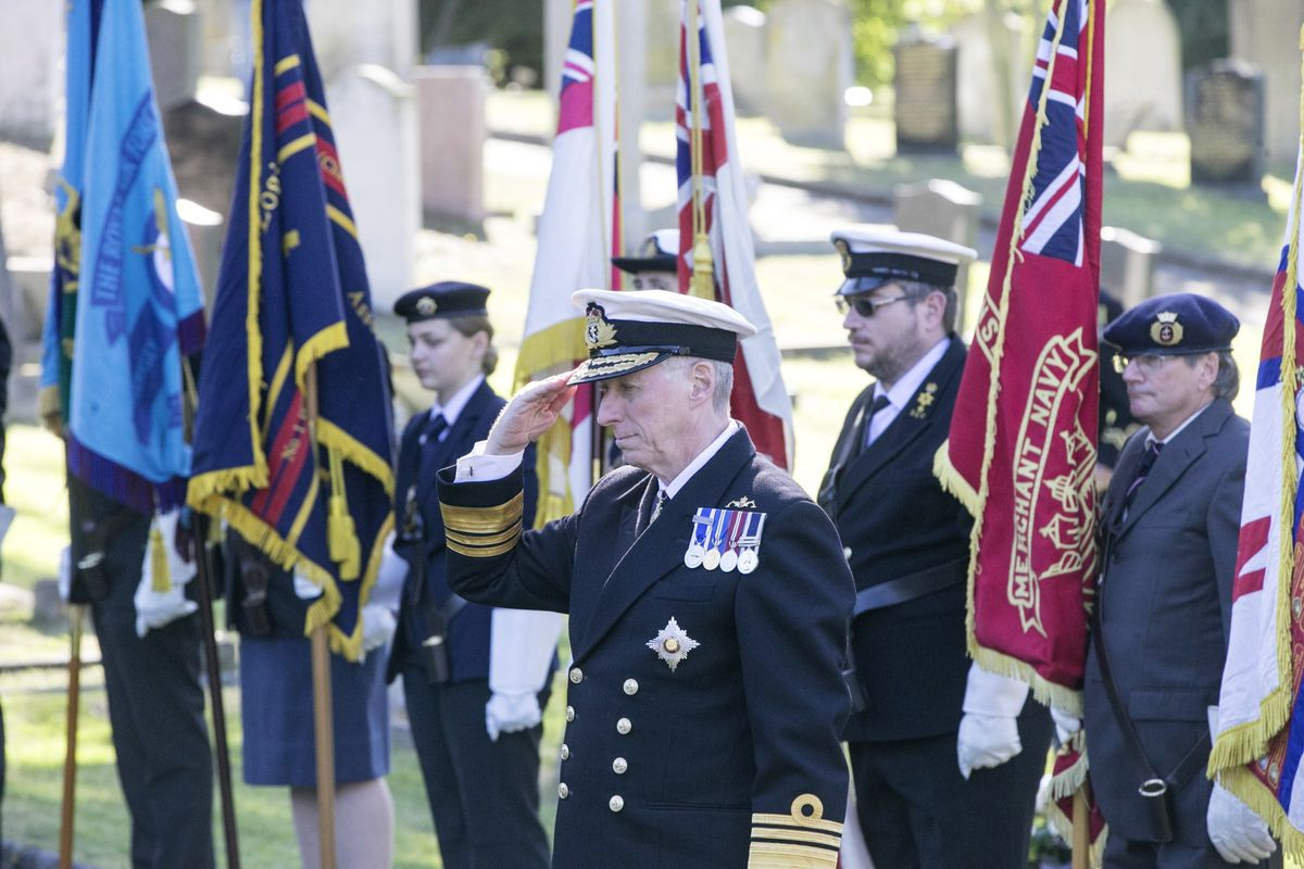 Pic by Adrian Miller 27-09-20 Foulon Cemetery. Remembrance service for H.M.S. Charybdis and H.M.S. Limbourne .  Lt Governor Vice Admiral Sir Ian Corder lays a wreath.. (28735067)