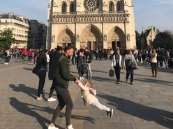 Search for man and child pictured playing in front of Notre Dame before fire