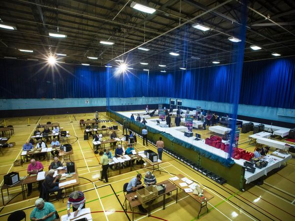 Volunteers at work counting the votes at Beau Sejour during the General Election. (28839653)