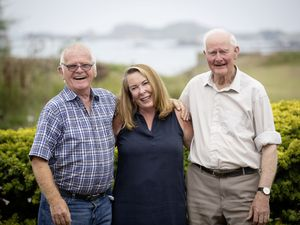 Marion Ashdown (centre) has been nominated for Neighbour of the Year. Pictured with some of her neighbours Roy Holland and Michael Williams. (Picture by Peter Frankland, 28566560)