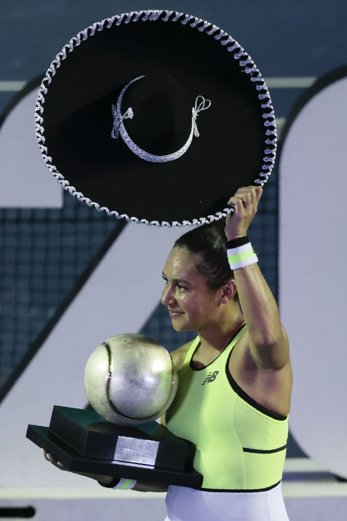 Hats off to Heather. The tennis star removes her sombrero after receiving her trophy for winning the Mexican Open against Canada's Leylah Fernandez in Acapulco.  (AP Photo/Rebecca Blackwell)