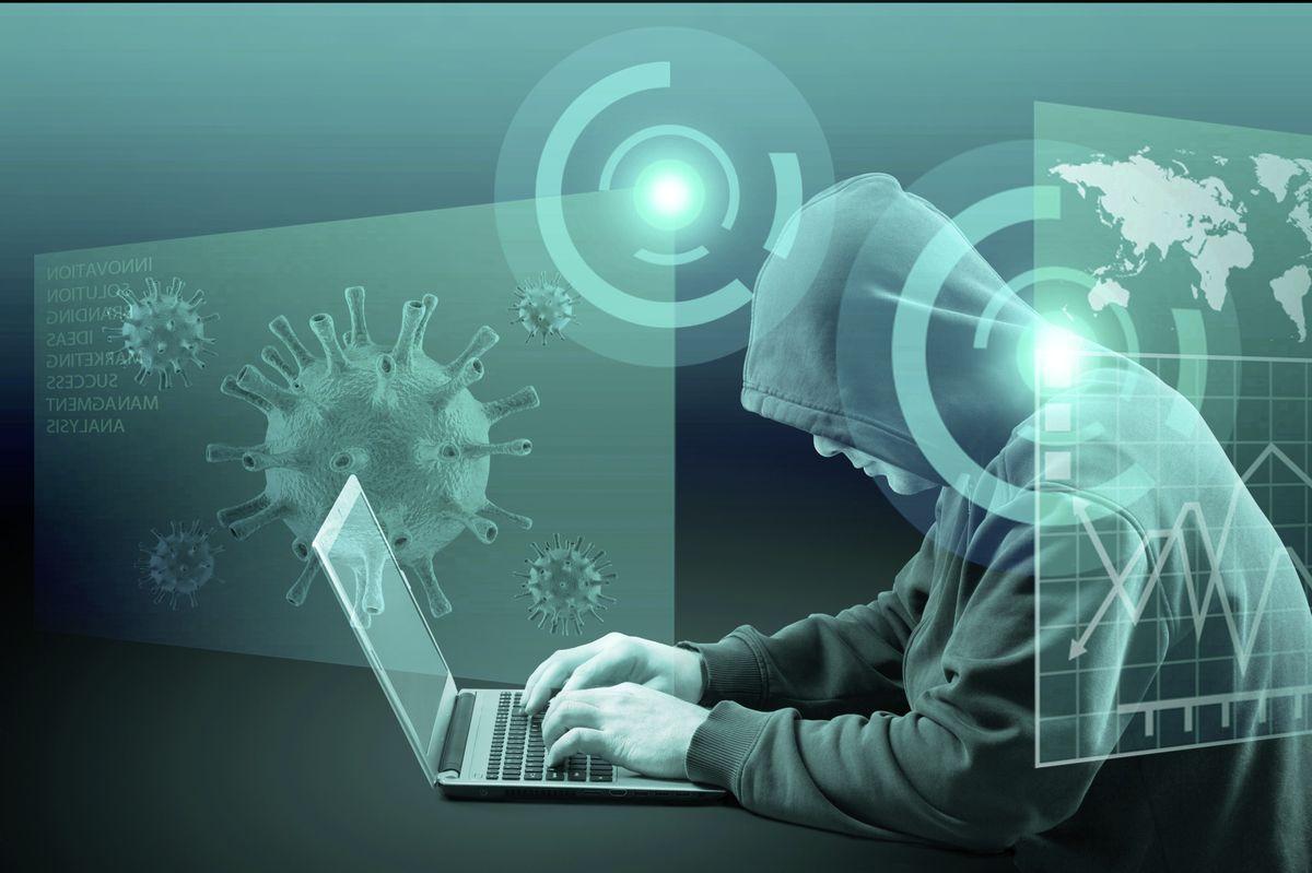 Hacker virus malware attack during coronavirus pandemic concept (29301135)