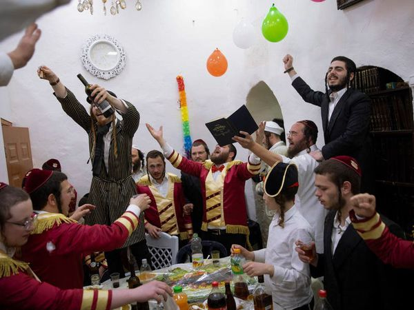 Purim celebrations threaten fresh virus outbreak in Israel
