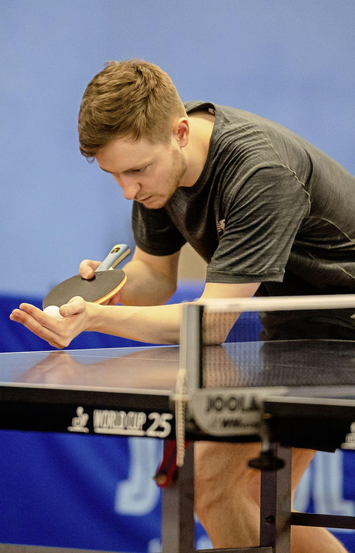 Josh Stacey serving up a second successive men's title.  (29502198)