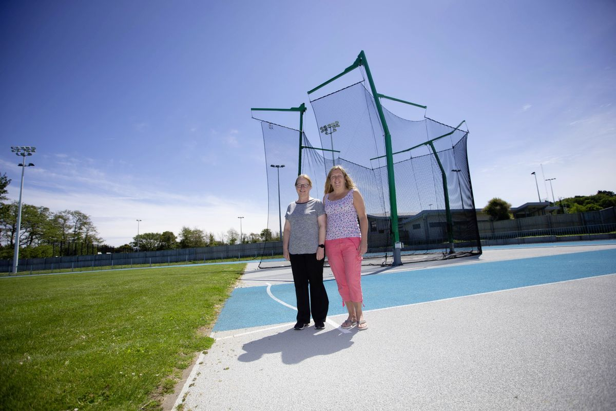 Michelle Galpin, left, and Linda Moroney began volunteering for Guernsey Athletics when their children became involved and have continued. (Picture by Peter Frankland, 29622279)