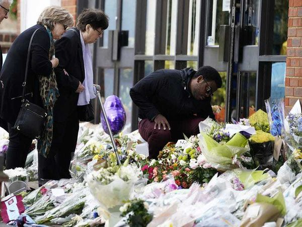Family of Sir David Amess view flowers and tributes left for Tory MP