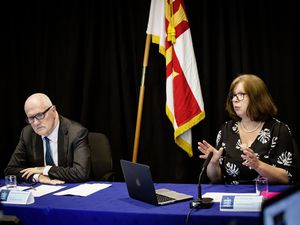 Civil Contingencies Authority chairman Deputy Peter Ferbrache listens as director of Public Health Dr Nicola Brink makes a point at yesterday's press conference. (Picture by Sophie Rabey, 29811687)