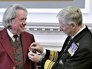 Ronnie Cairnduff, who came out of retirement as chief organiser of Alderney Week in 2020 to take the reins of a Covid-compliant event, received the British Empire Medal from Lt-Governor Vice Admiral Sir Ian Corder at a vin d'honneur at the Island Hall. (Pictures by David Nash)