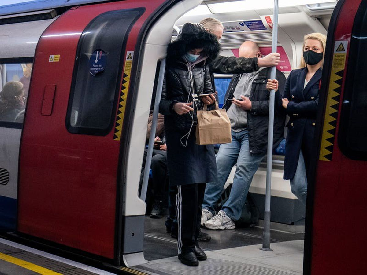 Train timetables reduced and Tube lines closed as 'pinged' staff self-isolate