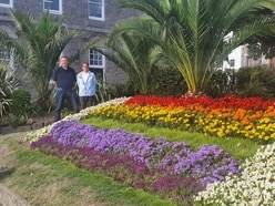 North Plantation flowerbed blooms with Pride
