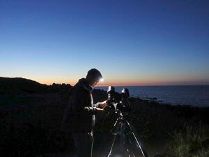 Astronomy student Thomas Harvey, pictured photographing the comet Neowise, recently had his nomination accepted for the fellowship of the Royal Astronomical Society. Image supplied by Thomas Harvey.  (28819005)