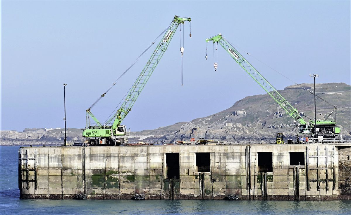 Alderney's new crane, right, was put together in three days. (Picture by David Nash)