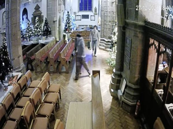 Guernsey Police are appealing for anyone with information about the two unknown men who entered Town Church on 27 December 2020 and stole some of the charity tins that were part of the Christmas Tree Festival. Screen grab from the CCTV footage shared by Bailiwick Law Enforcement. (29124589)