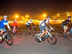 Cyclists get to ride the airport runway at night