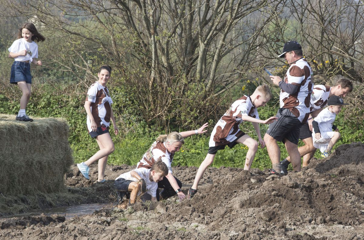 The run attracted entrants as young as eight and though much of the mud had to be 'made' by farmer Rob Waters, on whose land much of the event was held, there was enough to coat the runners. (Picture by Adrian Miller, 24565691)