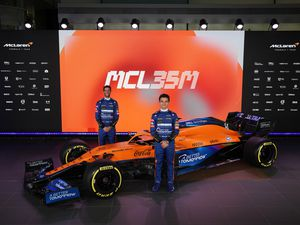 Drivers Lando Norris, right, and Daniel Ricciardo at the unveiling of the McLaren car for the 2021 F1 season. (McLaren F1/PA).