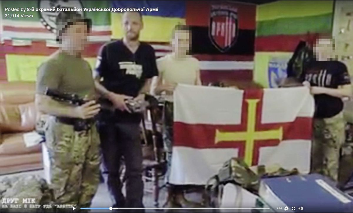 Mikus Alps, second left, appearing in an online Ukranian army video complete with Guernsey flag.