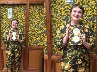 Writer at literary event accidentally ends up beautifully coordinated with book