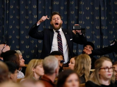 Trump impeachment hearing interrupted by protester