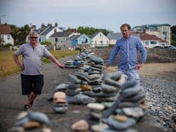 Pebble stacks to be recorded for social history