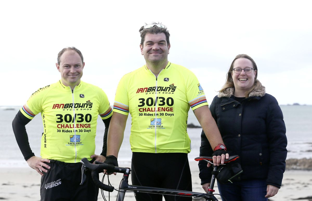 Pic by Adrian Miller 26-09-20 L'Eree Hill. Everest Madness cycling event. Ben Snook centre is the brains behind the event he is flanked by organisers Mark Oliphant and Jen Baudains.. (28732655)