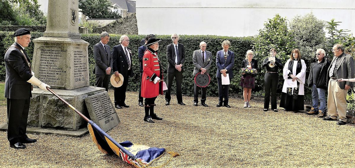 The ceremony included the Royal British Legion and town crier Kevin Moore. (Picture by David Nash)