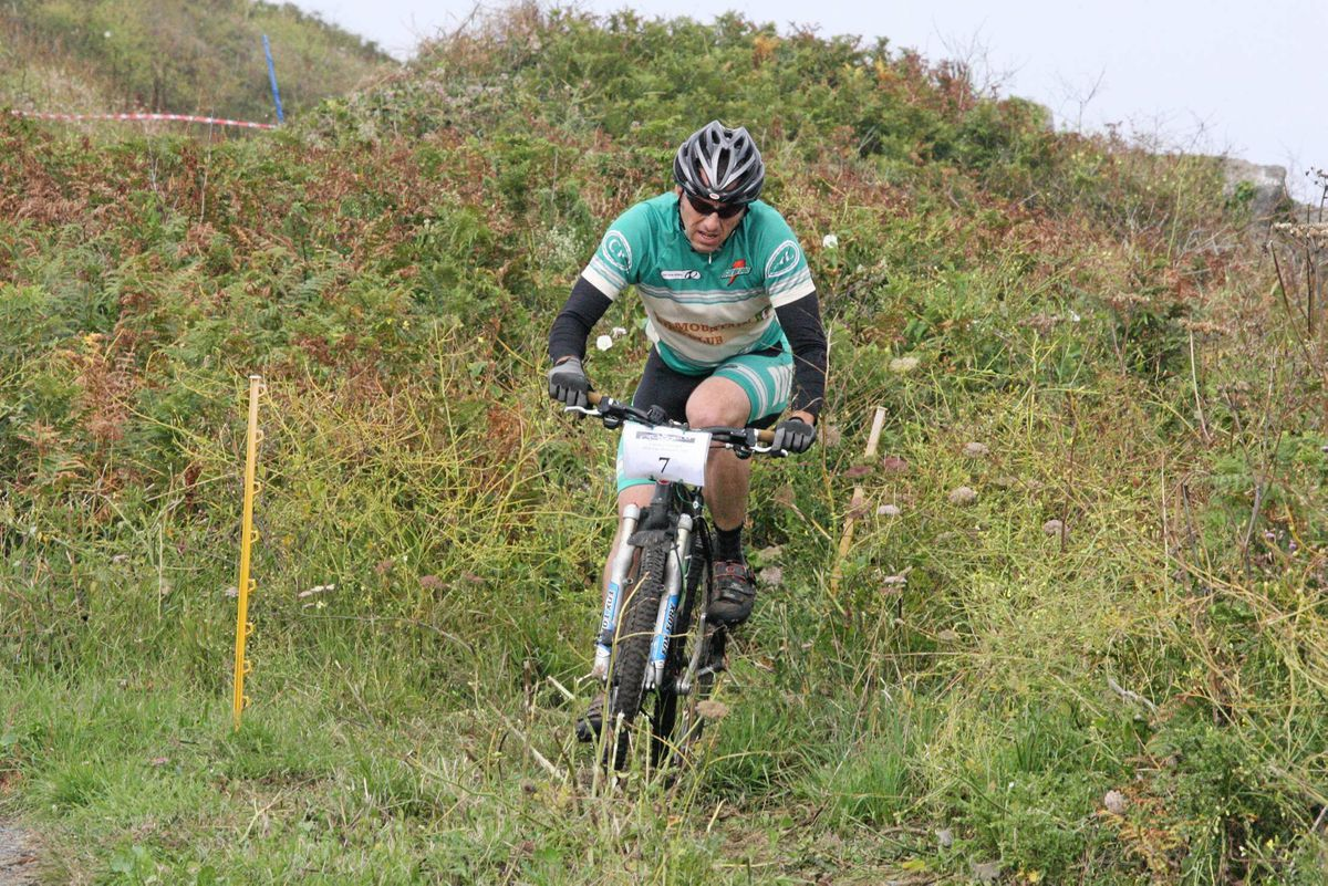 Velo Club president Mark Smith racing in a past Tour of Guernsey which will be delayed a little to allow more planning time.