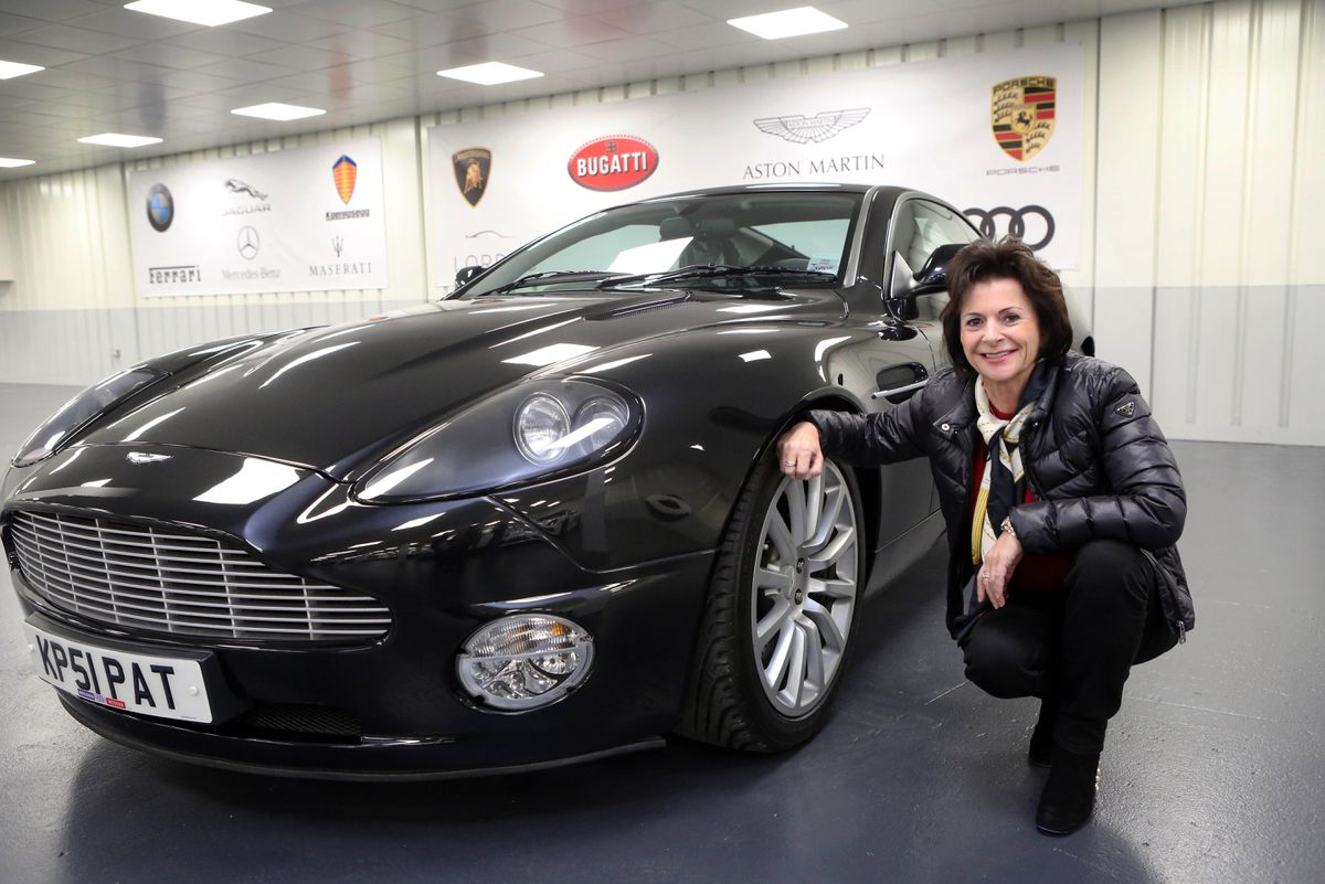 Lordes chairwoman Karen Lewis alongside the her pride and joy, a 2003 Aston Martin Vanquish.(Picture by Steve Sarre, 19814607)