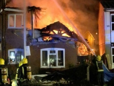Woman found dead after 'gas explosion' rips through flat