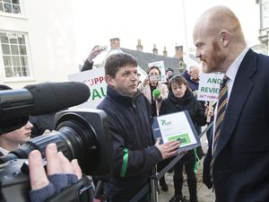 One of the People Power Guernsey organiser's, Mark Mauger, hands over a petition to Deputy Gavin St Pier at the meeting when the States approved the 'pause and review' requete. (Picture by Adrian Miller, 29322184)