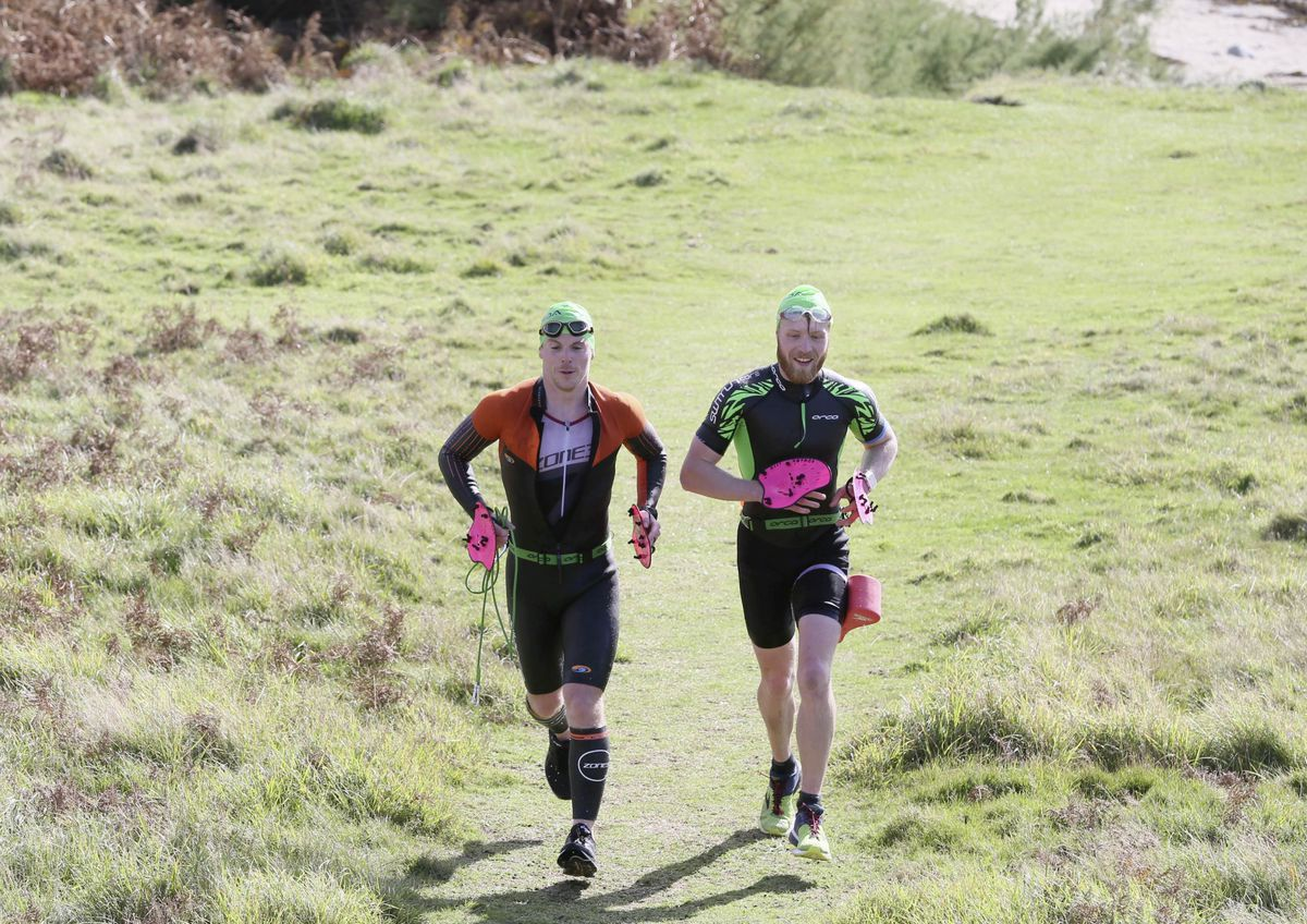 The Tri Hards pairing of Chris Norman, left, and James Tipper on their way to victory. (Picture by Adrian Miller, 28786300)