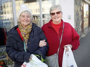 Margaret Bourgaize, right, who was shopping with June Fox, was happy to pay for a carrier bag if her money went to good causes. (Picture by Adrian Miller, 23483437)