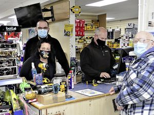 Glad to be back behind the counter at Blanchard's hardware store and DIY centre are from the left, Margo Jakubowska Konrad Olbrycht, and Alistair McDonall with customer Terry Noon. (Picture by David Nash)