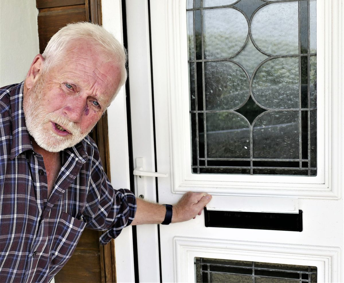Alderney resident Neil Harvey waiting in vain by his letter box for his vaccine status certificate. (Picture by David Nash)