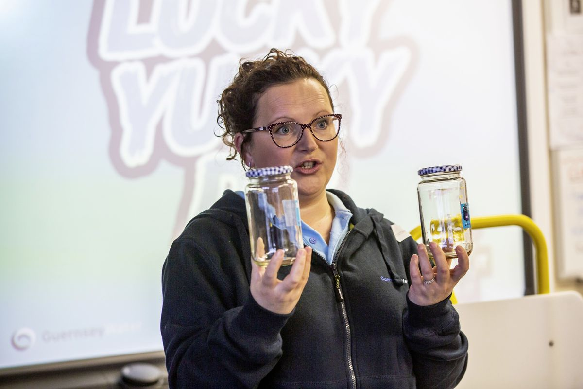 Catherine Boughay, Guernsey Water's communications officer, with some jars that it is leaving with the school to do a decomposition experiment. (28950979)