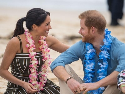 In Pictures: Duke of Sussex holds hands with pregnant wife on Bondi Beach visit