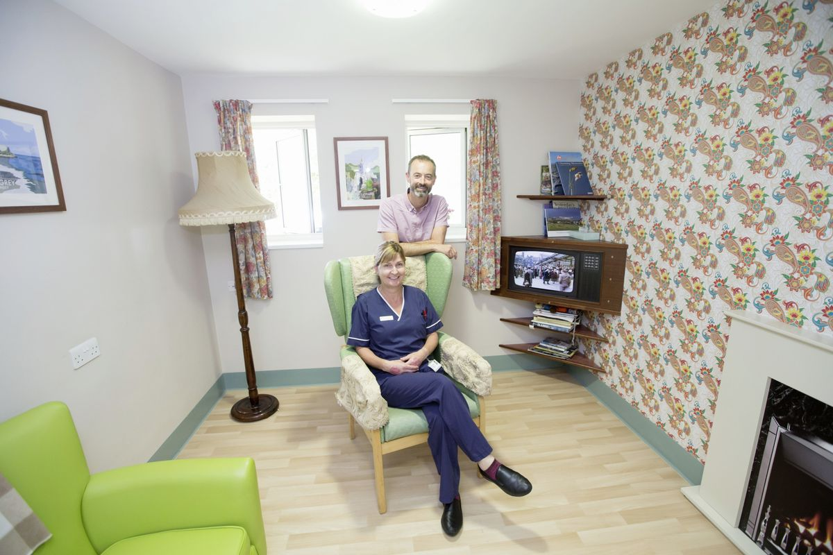 Mr Colmer and Roustel Ward manager Ellie Knowles in the reminiscence room, complete with floral wallpaper and black and white TV, which harks back to 1953.  (25463302)