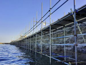 Picture by Peter Frankland. 17-09-21 Scaffolding on the wall at the Longstore. Repointing work on the wall is nearing completion.. (29996992)
