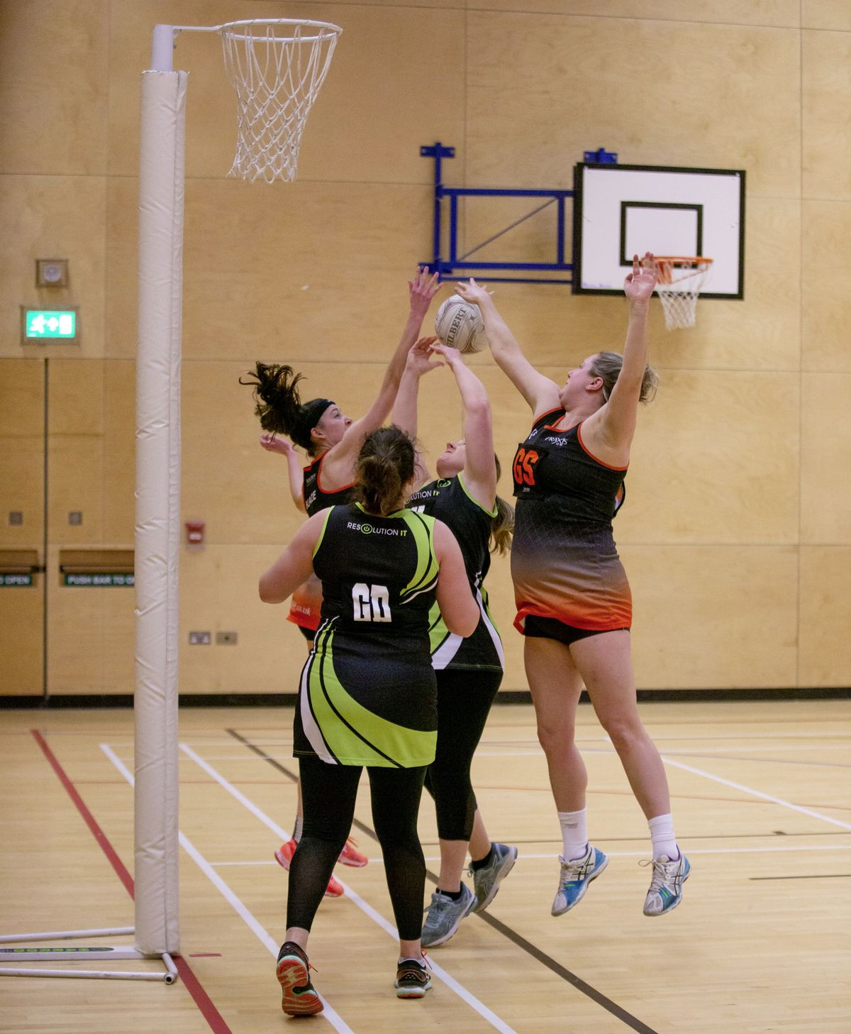 Blaze shooting duo Abbie Greening (far left) and Zola Saunders (far right) both compete for a rebound with GK Lois Batiste. (Picture by Sophie Rabey, 29408215)