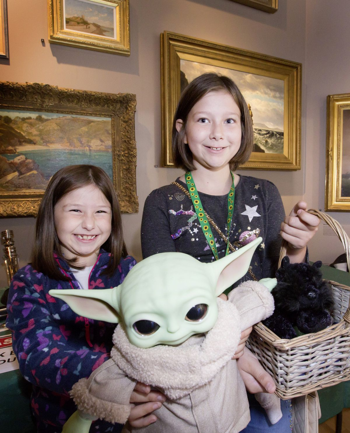 Left to right: Sisters Molly, 8, and Taylor, 10, Glendinning with baby Yoda. (28734604)
