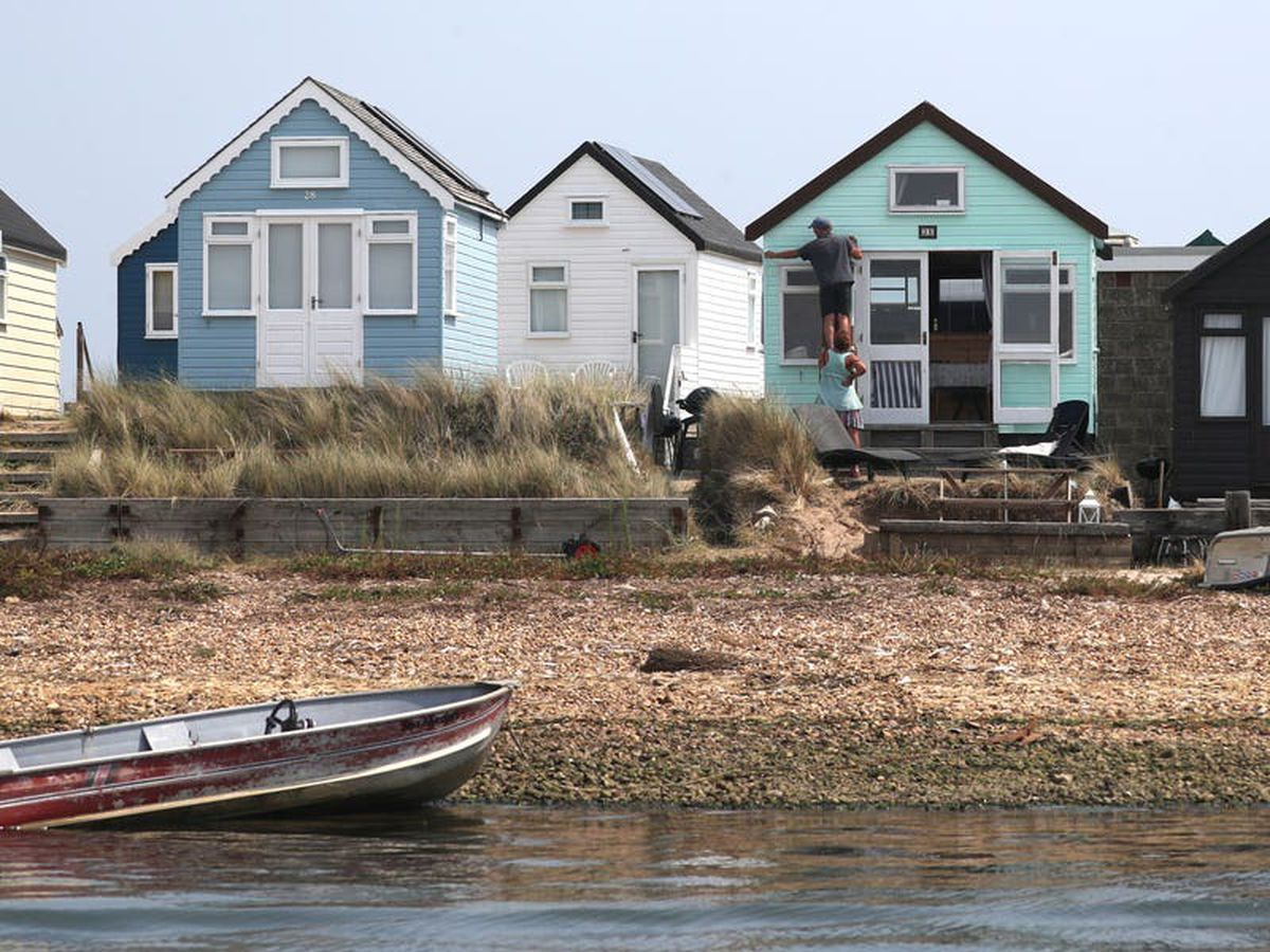 Two arrested over beach hut attacks