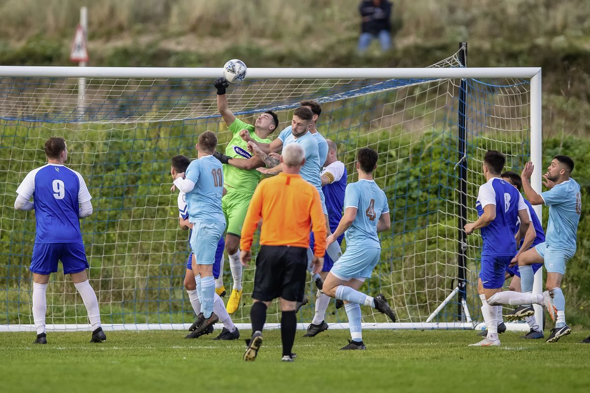 Rovers goalkeeper Adam Bullock punches clear under pressure from several Northerners including goal-scorer Sam Murray at Port Soif on Saturday. (Picture by Martin Gray, www.guernseysportphotography.com, 07-11-20. (28887862)