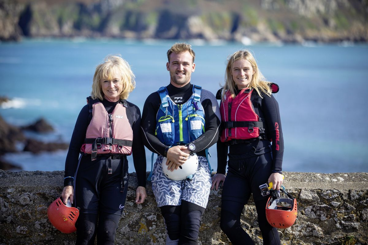 Hannah Mackay, right, is raising money for dementia charities by taking on challenges around the UK. Yesterday she was coasteering with Outdoor Guernsey at Le Gouffre. Pictured with her are mum Claire Pearse, and Outdoor Guernsey's Dom Ehmann. (Picture By Peter Frankland, 25962171)