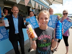 Destiny, 11, on a refillable mission at island's beach kiosks