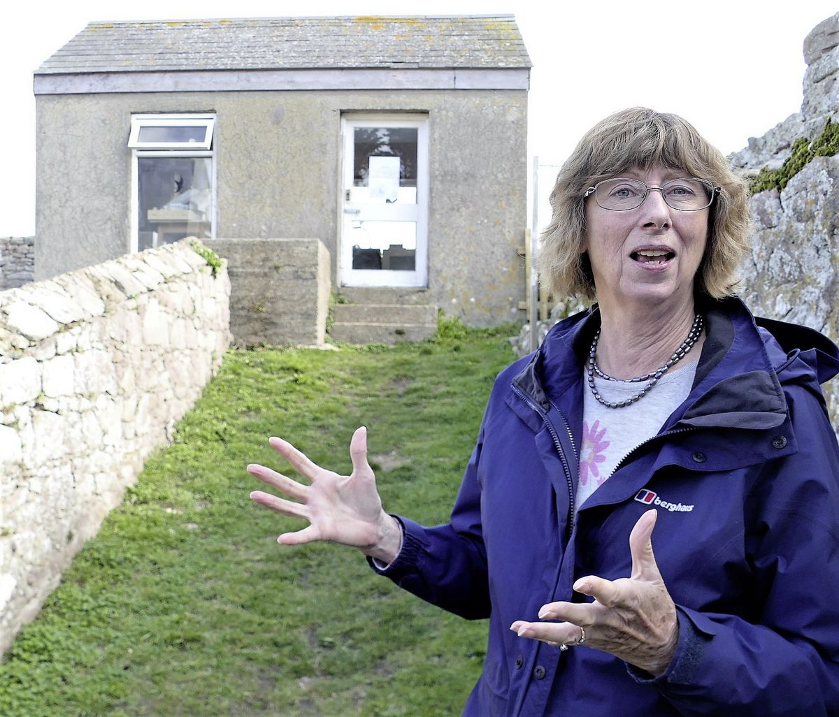 Alderney Bird Observatory director Norma Paris outside the building used by the group as a ringing room, which is due to be demolished. (Picture by David Nash)