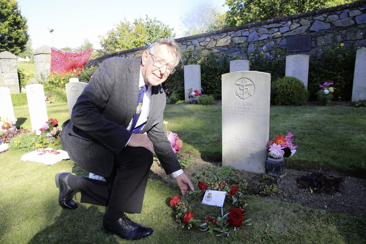 Pic by Adrian Miller 27-09-20 Foulon Cemetery. Remembrance service for H.M.S. Charybdis and H.M.S. Limbourne . Peter Carey member of the Charybdis and Limbourne Association lays a wreath.. (28735097)