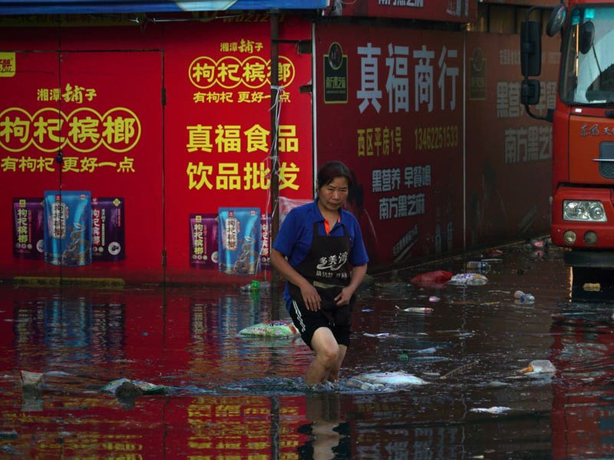 Death toll in central China floods now exceeds 300